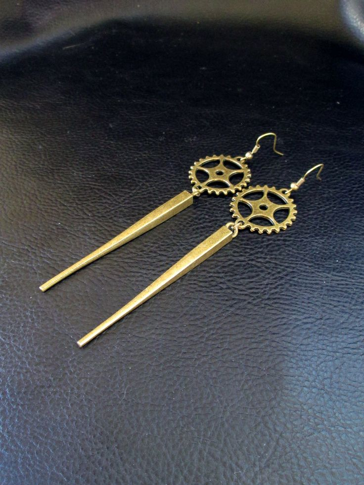 Industrial spike earrings, antique brass tone cogwheel gear and spike shoulder dusters, long modern statement earrings by LogicFreeDesign on Etsy https://www.etsy.com/listing/194656900/industrial-spike-earrings-antique-brass