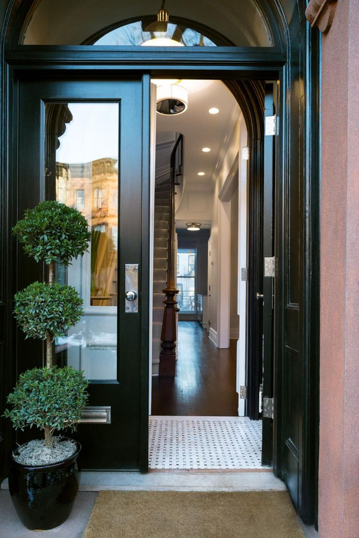 Like the brownstone itself, this small vestibule is charmingly old-school with a lot of history.