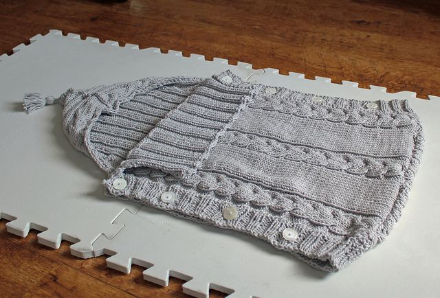 I'm knitting this Baby sleep sack by Susan Flockhart for Aunt E's daughter L who is expecting in September! It's easier than a sweater because squirmy little babies can just slide right in :)