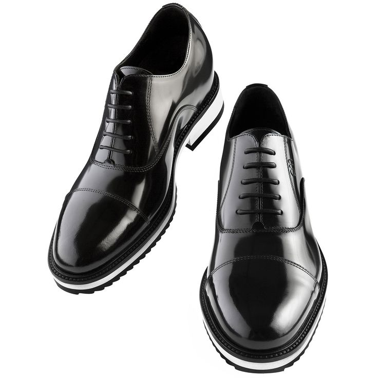 Cannes - Elevator dress shoes. Upper in shiny black calfskin, insole and midsole in genuine leather, Cotton waxed shoe laces. Hand Made elevator shoes in Italy by www.guidomaggi.com/us