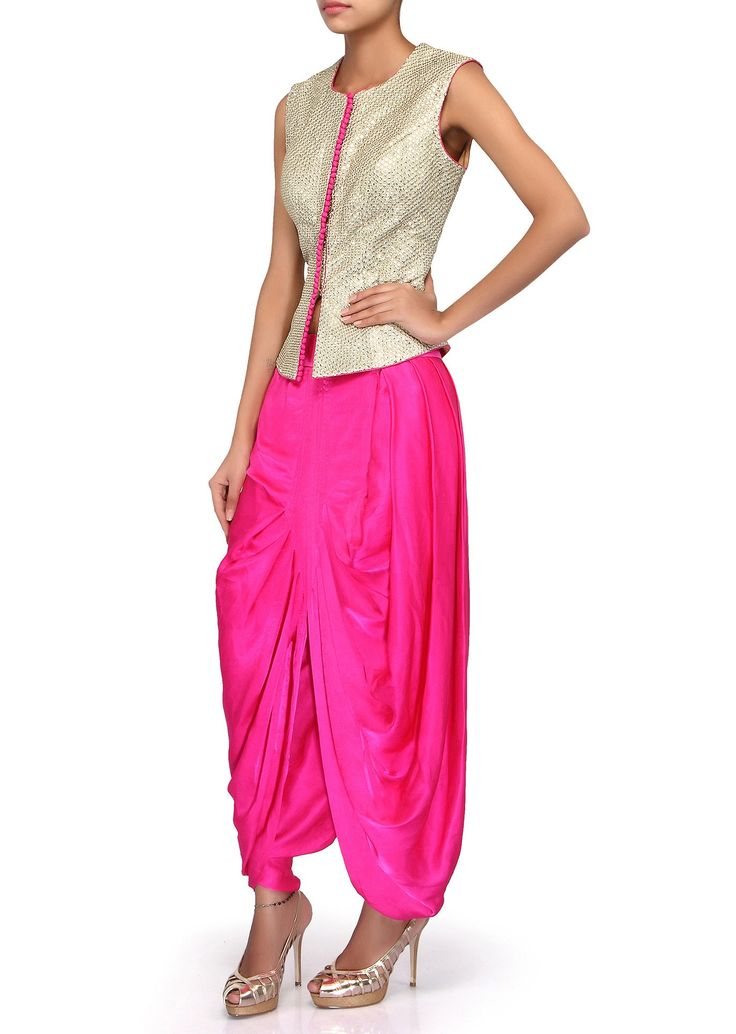 Gold outfit featuring with top in sequin and zari embroidery. Its mathced with pink satin dhoti with cowl drape.
