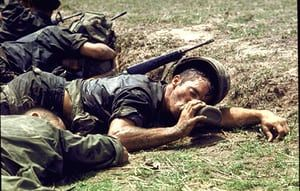 1970 An exhausted American infantryman drinks from his canteen in the Fishhook area of Cambodia