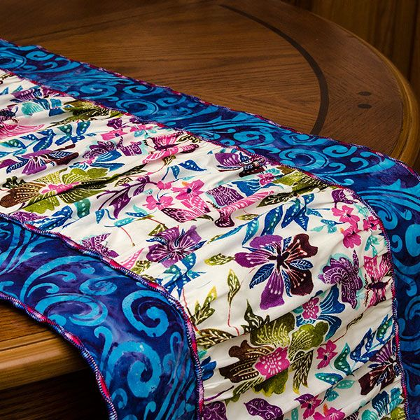 Whip up this quick ruffled table runner completely with your serger! This project works great with Baby Lock Sergers that have the Wave Stitch, but, an Overlock stitch would look great, as well! Happy National Serger Month!