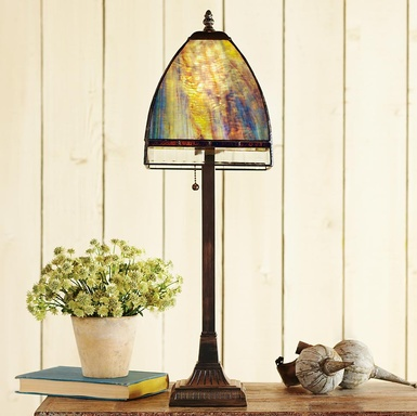 Sheridan lamp this blue green lamp shines with a soft glow thanks to its handcrafted stained glass the bronze finished base is made of cast resin