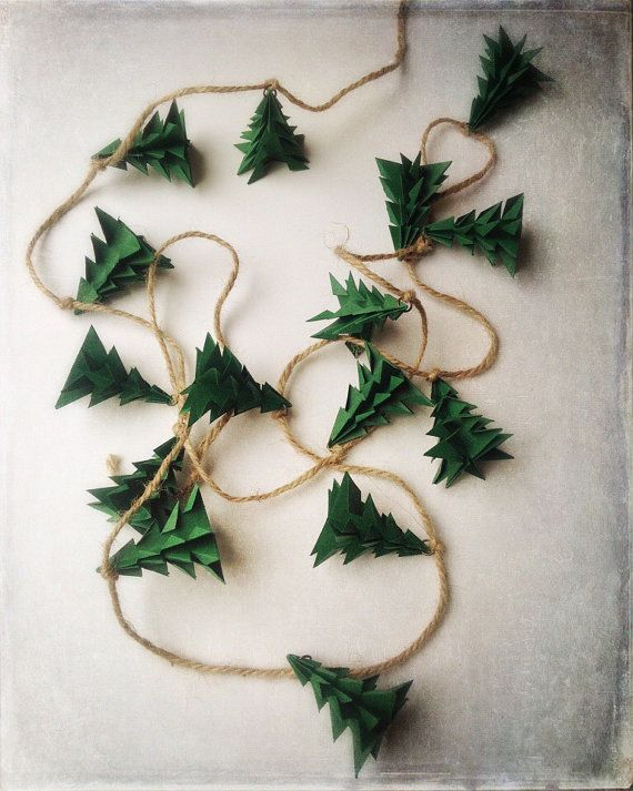 *Please read this listing carefully. It has recently been changed to add more buying options!  This adorable rustic evergreen garland is now available in two lengths. Please select your length at checkout! The 6 1/2 foot garland strand contains 15 - 2 inch tall trees that are folded from dark green acid free paper. The trees are connected by brass jump rings to jute 2mm 20lb cording. The ends of the garland are accented with lovely 11mm brass star beads. The 4 1/2 foot garland strand is…