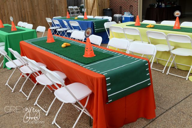 Cute idea of using green outdoor carpeting, sports cones & such.