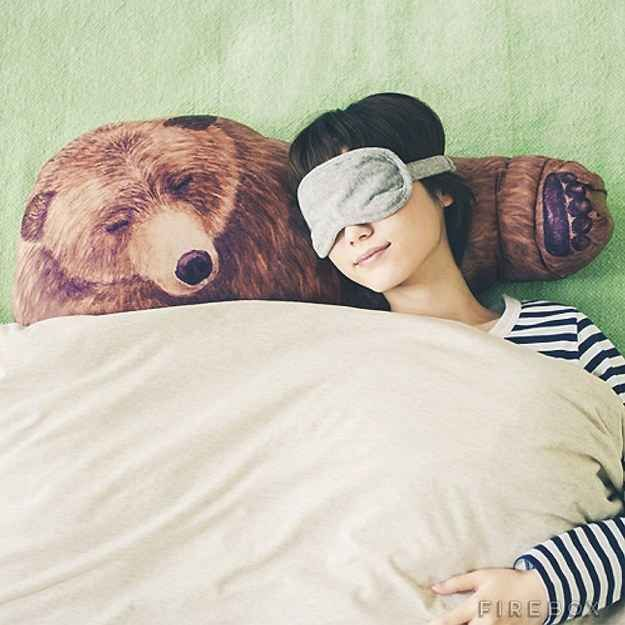 A pillow that gives you a big bear hug every time you doze on his arm: