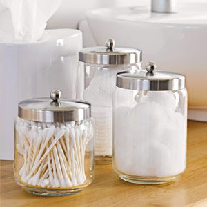 #Organizing #Tip: Eliminate countertop chaos with a few decorative solutions. Store cotton balls and swabs in glass jars and tissues in a sturdy holder.