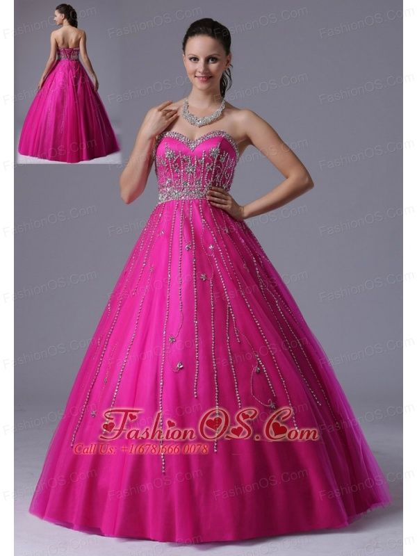 Custom Made Fuchsia A-line Beaded Decorate Prom Dress With Sweetheart In Arizona  http://www.fashionos.com  Wow! This dress is so catching and elegant, it creates a touching effect which makes you the hotline. It features a strapless bodice with sweetheart neckline. The heavily embellished handwork beading on the neckline extends to the bust and waist and the skirt, which cause much attention to this part. What's more, the soft tull adds more charming to the dress.