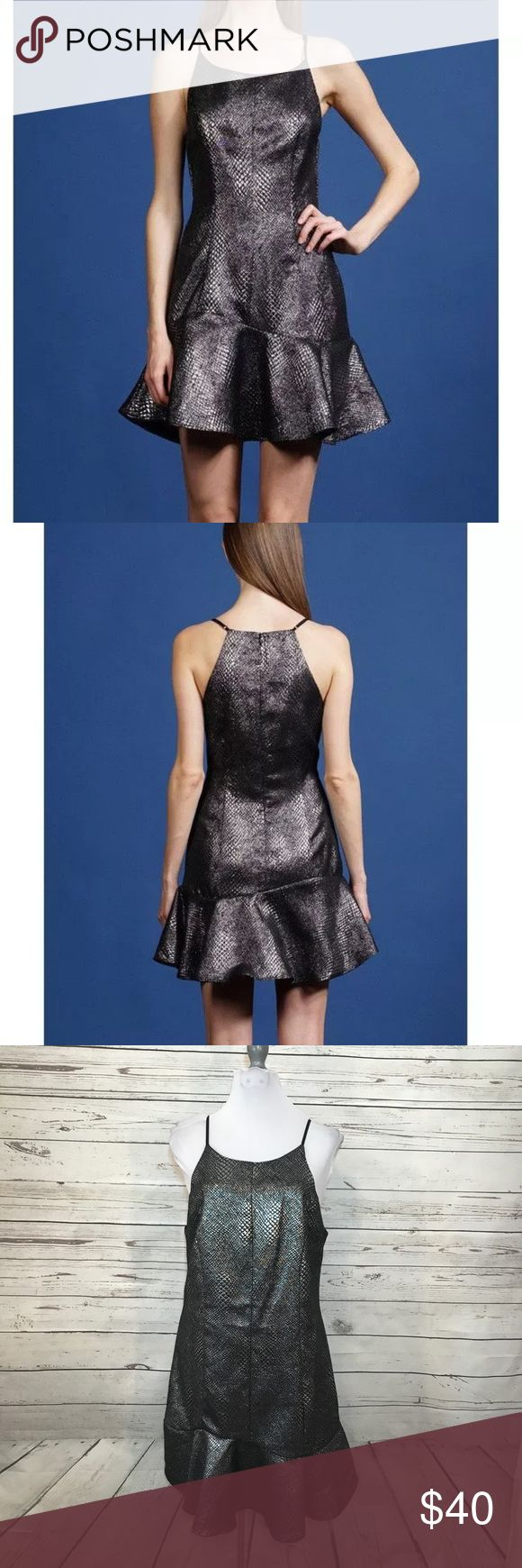 """NWT Adelyn Rae metallic gunmetal snake print dress Brand New With Tag. Adelyn Rae dress with trumpet skirt. Size Large. Metallic Gunmetal/silver snakeskin print. Adjustable Straps.    Armpit to Armpit: approx 18"""" Waist: approx 16.75"""" Shoulder to bottom: approx 34.5"""" (adjustable straps) Adelyn Rae Dresses Mini"""
