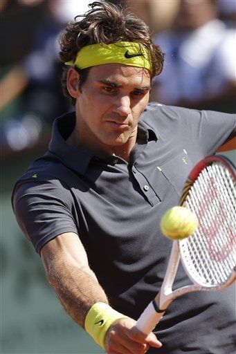 Roger Federer of Switzerland returns in his semi final match against Novak Djokovic of Serbia at the French Open tennis tournament in Roland Garros stadium in Paris, Friday June 8, 2012. (AP Photo/Michel Euler)