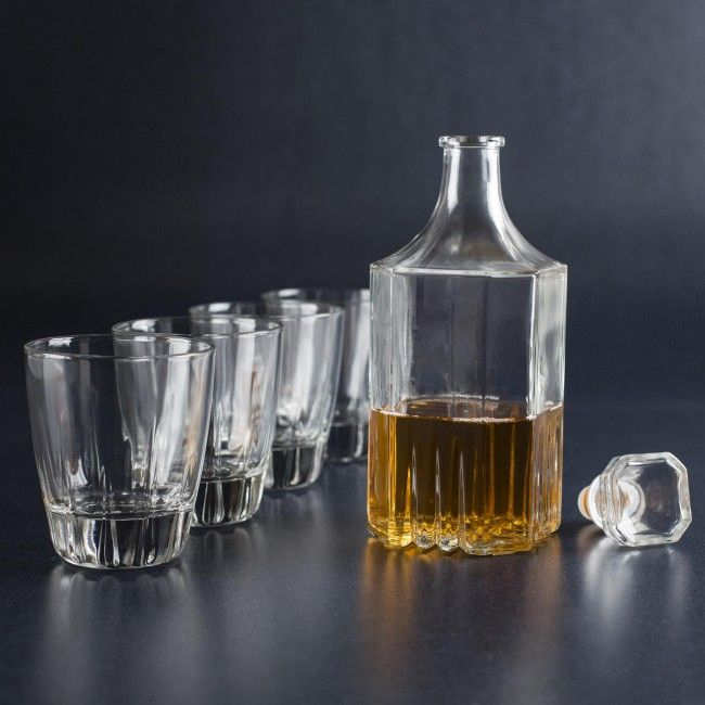 This Decanter Set is the ultimate showcase for your finest drinks. The matching elegant design on both the decanter and the glasses make it a sleek choice for the home bar.