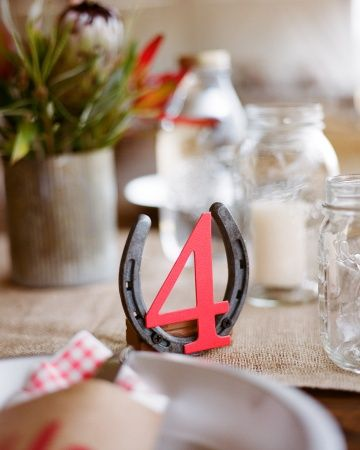 Horseshoes for table numbers. Love it!