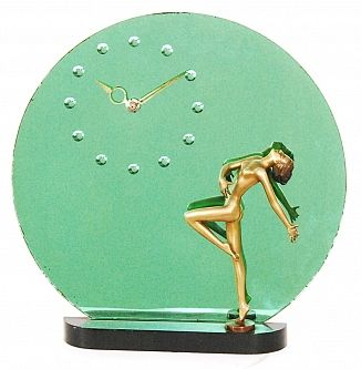 A 1930's Art Deco figural clock by Josef Lorenzl, the black lacquered base mounted with a female nude bronze in dancing pose before a green mirrored circular panel with integral clock, figure signed to the base, overall height 37.5 cm.