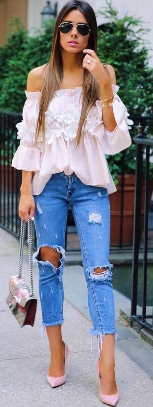 Love the ruffles and flowers on the top. I would wear it with less torn jeans.
