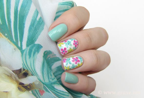 The new nail design - two patterned, three straight colours. Summer flowers nail art from Nail Polish Reviews.