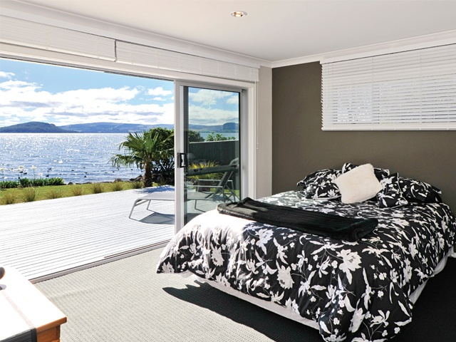 Stunning lakefront views from the fully serviced master suite.