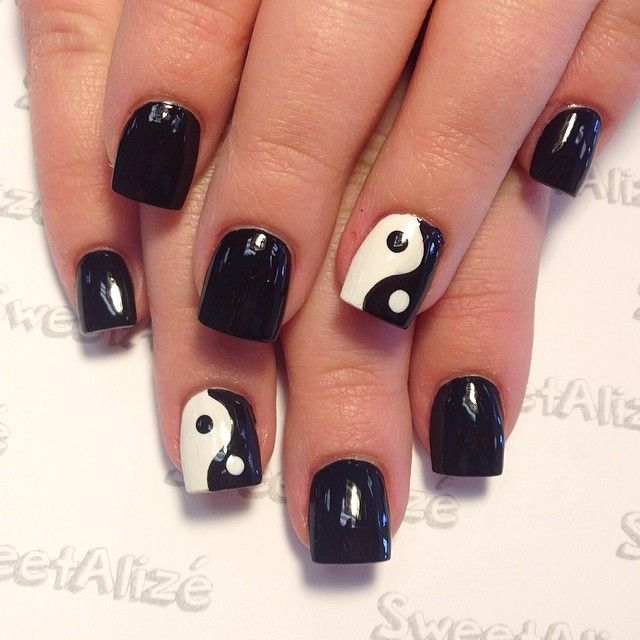 I'd do one hand with white nails and the symbol. And the other with black nails.