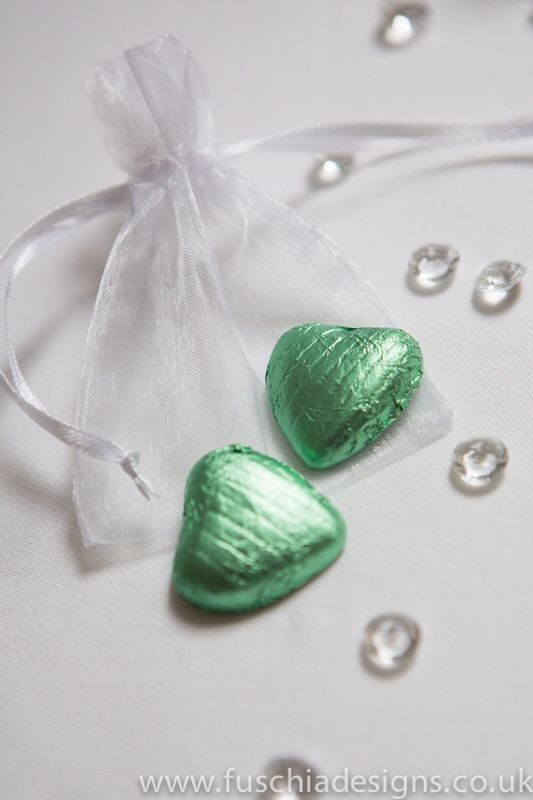 Wedding favour voile bag with milk chocolate hearts in peppermint green. £1.25 each. www.fuschiadesigns.co.uk