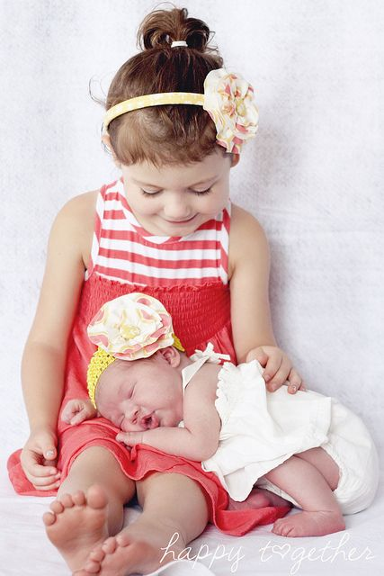 Cute sibling idea- don't have to trust the older sib to hold them sitting up for the whole picture!