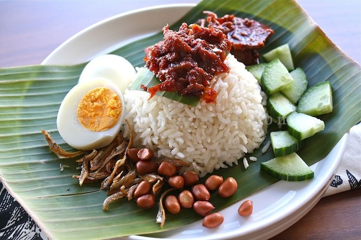 Nasi Lemak.  Coconut rice with  chilli sauce fried anchovies, roasted peanuts, hard-boiled egg and cucumber slices. I remember being served this for breakfast and I insisted on cereal. Way too heavy to eat in the mornings!