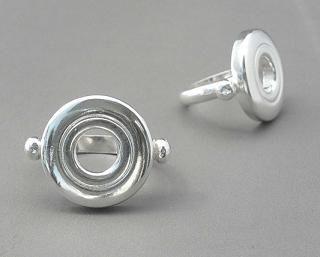 kinda cool, kinda weird. But I kinda want it. Open hole flute ring.