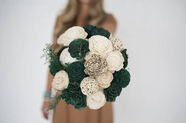 It's easy being green with the Tree Hugger bouquet. Sustainable wood flowers in shades of juniper green, natural white, and potato have minimal impact on the earth and last forever. Being green has never been easier or more beautiful!  Made from two dozen forever flowers.  Colors: Juniper green, natural white, potato