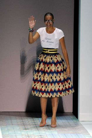 """Designer Stella Jean acknowledges the audience as she wears a shirt with writing in Italian reading """"Thank you Mr. Armani"""", at the end of he..."""