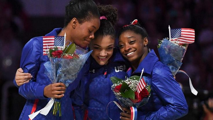 Gabby Douglas, Laurie Hernandez and Simone Biles celebrate after making the women's U.S. gymnastics team for Rio.