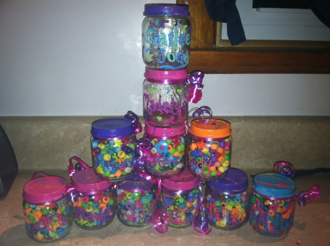 Party favors, painted baby food jars with beads in them.