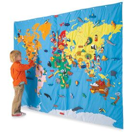 Use the Overhead Projector, put a world map on a sheet - color it with felt, fabric paint or  markers.  If felt, the labels, plants, animals, etc. can be backed with felt and will stay in place, otherwise they can be pinned to it.