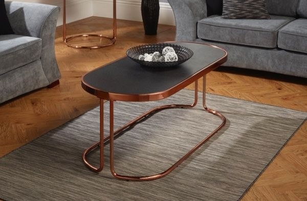 Stylish retro coffee table in rose gold with stone effect glass top