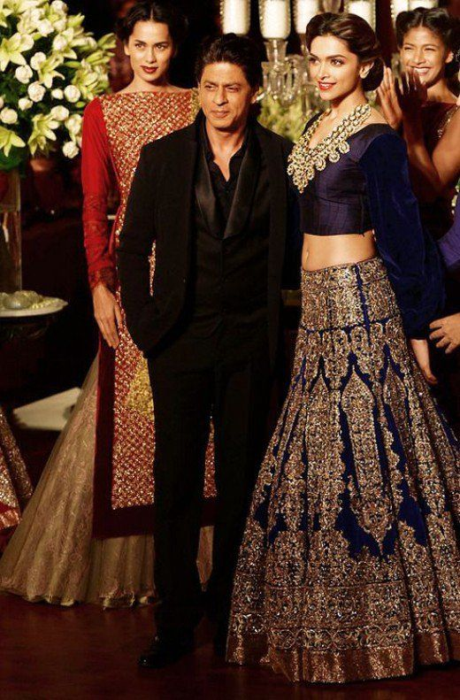 Deepika in a royal blue designer bridal lehenga with Shahrukh Khan at her side