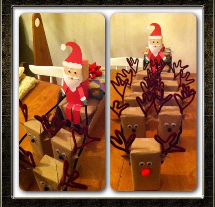 """Christmas present for baby- box of formula wrapped like Santa and his reindeer. Box of 12 formula: 9 reindeer, 1 Santa and 2 """"presents"""" in the sleigh. Sleigh is made out of a container of baby wipes."""