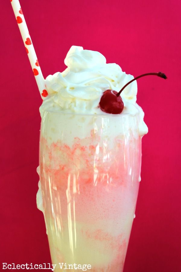 Cupid Float - 2-3 scoops French vanilla ice cream , Cherry 7-Up Whipped cream, Maraschino cherry Scoop ice cream into a tall glass Slowly pour 7-Up over ice cream Swirl whipped cream on top. Top with maraschino cherry
