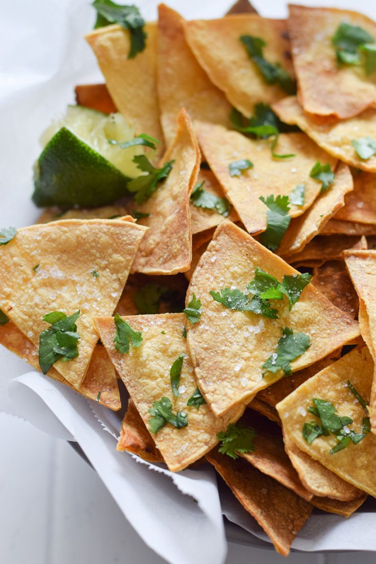 These Homemade Lime Tortilla Chips are crunchy, salty, easy to make and are baked with a hint of lime for a nice little zesty kick.