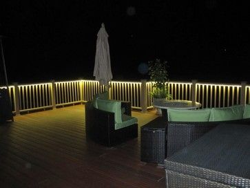 Love the idea of putting LED rope lights under railing to light up deck area.  No more awful overhead lights.