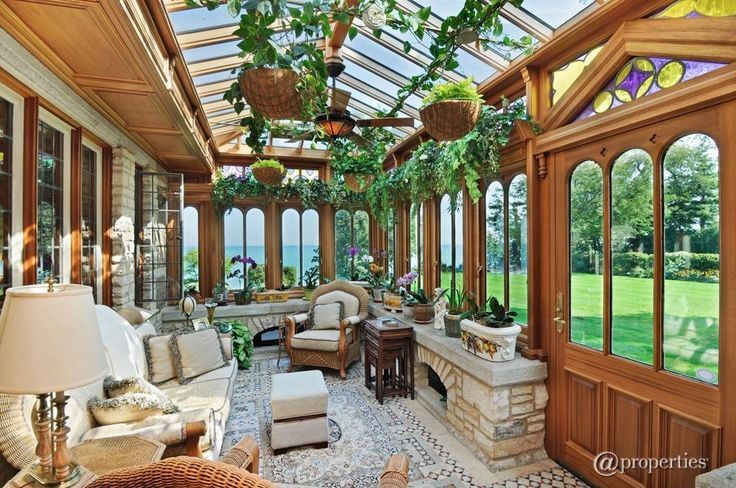 Craftsman Porch with Glass panel door, Stained glass window, outdoor pizza oven, Screened porch, Arched window, Skylight