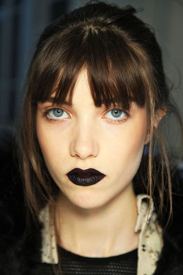 Hear us out for a second. Black lipstick can be your friend — it just can't be friends with any other product on your face. Minimal bronzer, no liner (not even mascara) — and this looks epically chic