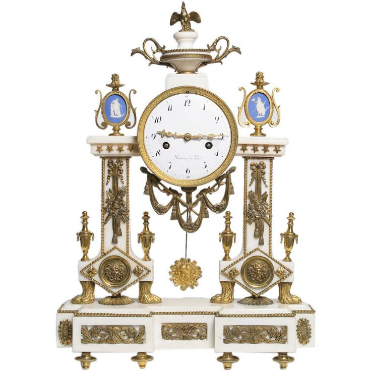 Rare Louis XVI Period White Marble Mantle Clock  France  circa 1780  Rare Louis XVI period white marble mantle clock extensively decorated with very fine gilt bronze mounts, the white enamel dial flanked by two oval Wedgwood cameos depicting neoclassical figures.
