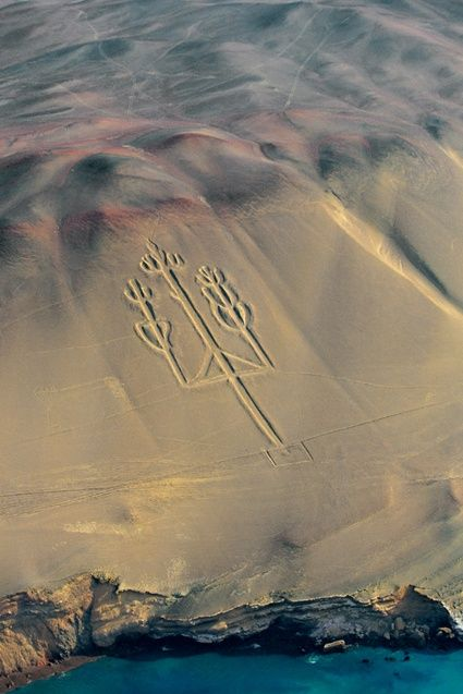 """Candelabra"" of Paracas Peninsula, Peru.  Carved into a coastal cliff, this geoglyph is 650' high x 200' wide.  Although similar to the Nazca Lines that lie 125 miles southeast, it was made by an earlier civilization, the Paracas, who lived about 650 BCE.  Visible from far out at sea, the Candelabra was a navigational landmark, as it still is today.  Photo by Y.A. Bertrand."