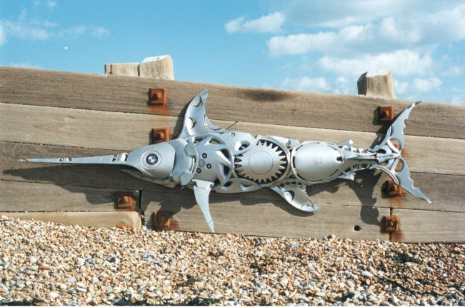 swordfish bmw eye Car Part Art - Old Recycled Hubcaps Into Awesome Sculptures