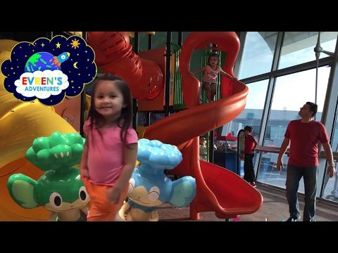 Indoor Playground Fun Kids Play Area Airport Family Fun Pack Vacation Trip Singapore Kids Fun Games. Evren and Evren's family had a family fun playtime with indoor Play Area for kids at Singapore Changi family friendly airport. There are many kids playing at the children Indoor play Centre. Evren had a lots of fun playing and she loves this fun indoor airport amusement park because kids can slides, climb around the play area.