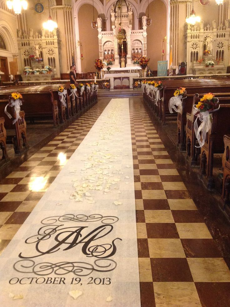 Beautiful fall romantic wedding aisle in church with a personalized wedding aisle runner