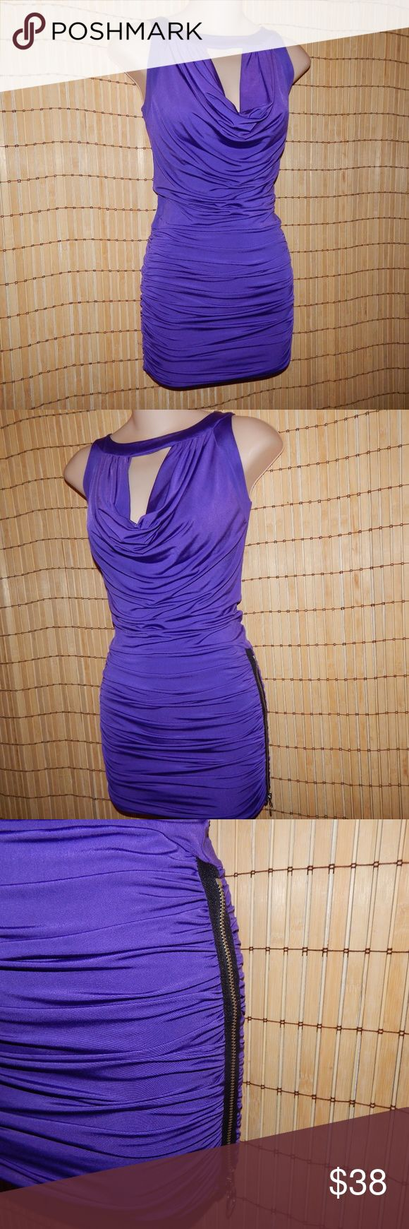 Frederick's of Hollywood purple dress Sexy! Slinky with a bold zipper down one thigh. You will turn heads in this one! This is a nice grape purple. Excellent condition. Bodycon. Frederick's of Hollywood Dresses Mini