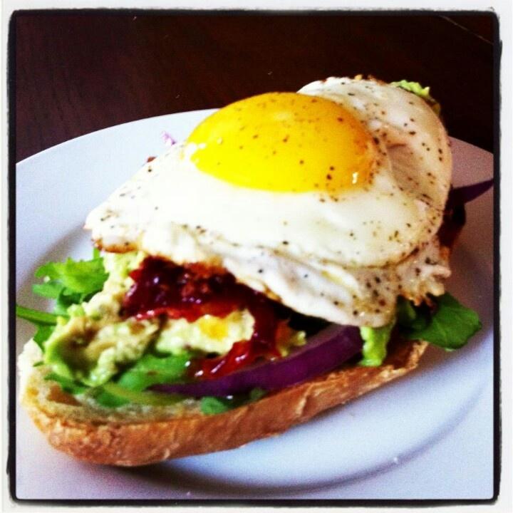 Egg, sun dried tomato, red onion, avocado and arugula on crusty bread