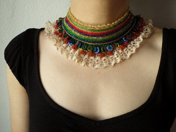 beaded crochet collar necklace with black, orange, red, gray, blue and green seed beads and crocheted lace