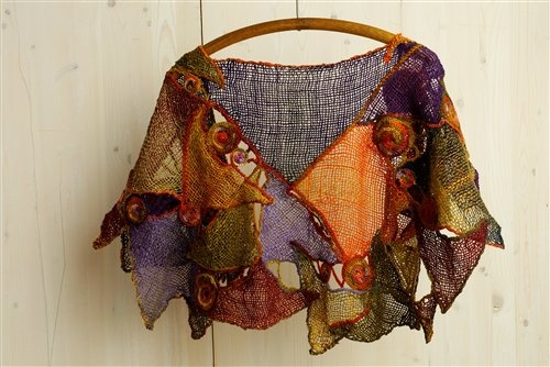 crochet used to link woven elements in this stunning freeform capelet by Zann Carter - winner of the most innovative use in competition by Weaving Today