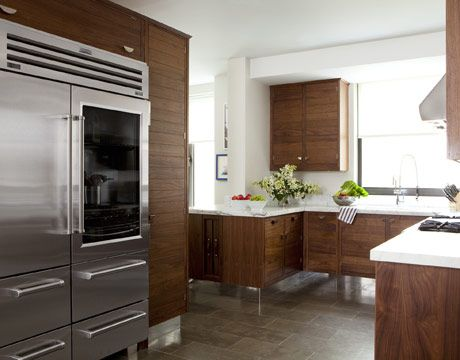 Modern Wood Kitchen  Raised cabinets from Smallbone make for easy cleaning in the kitchen.