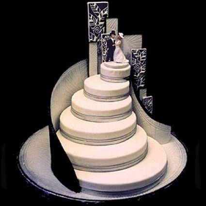 Off Center Tiered CAKE - Could look like a staircase- Not so windy and fewer tiers could be like a veil?- I think an oval shape would be elegant.